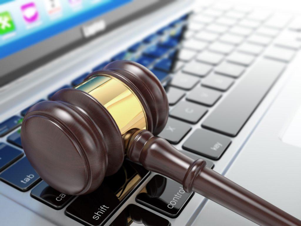 Online auction. Gavel on laptop. Conceptual image. 3d; Shutterstock
